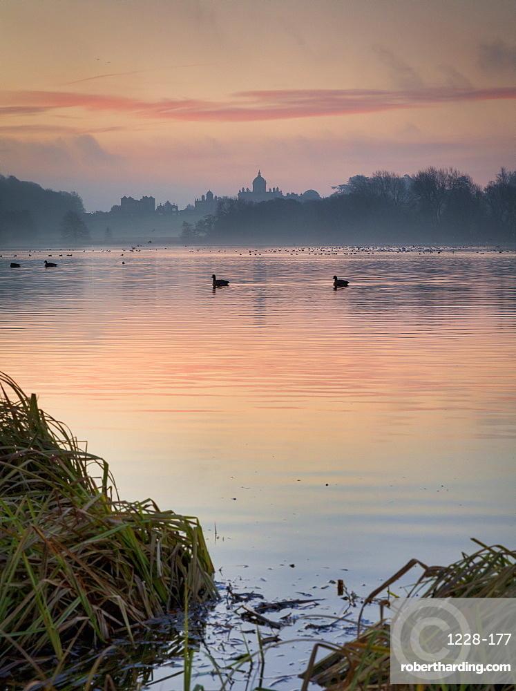 Winter sunrise over The Great Lake, Castle Howard Estate, North Yorkshire, Yorkshire, England, United Kingdom, Europe