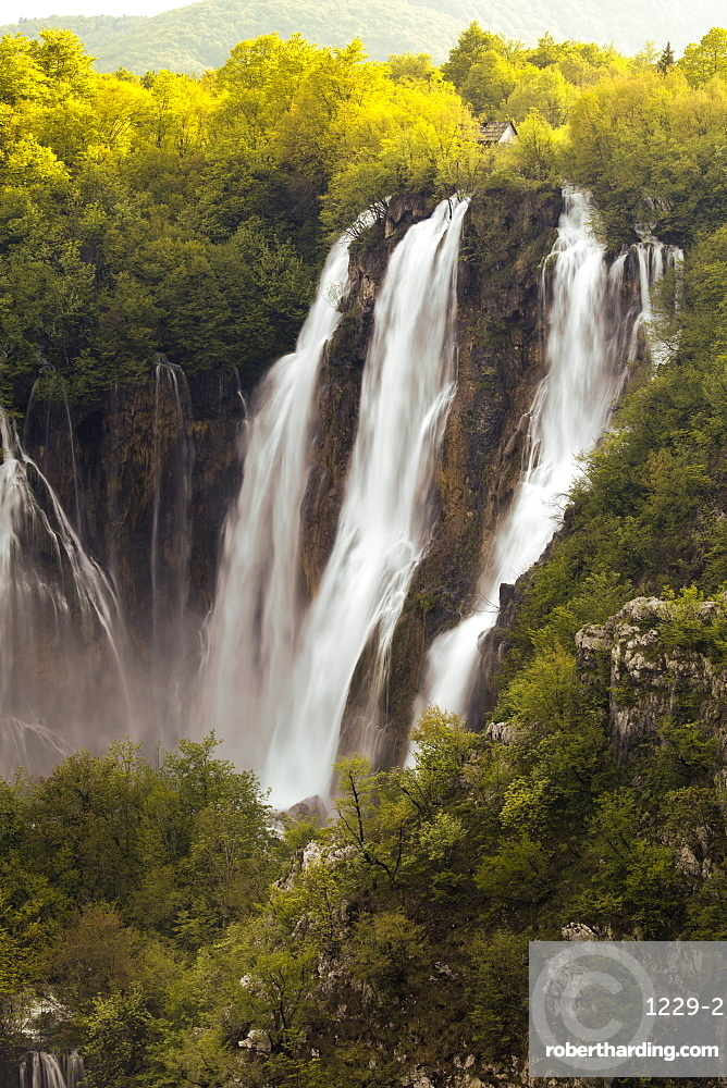 Heavy flow of water into the canyon at a large waterfall after heavy rain, Plitvice Lakes National Park, UNESCO World Heritage Site, Croatia, Europe