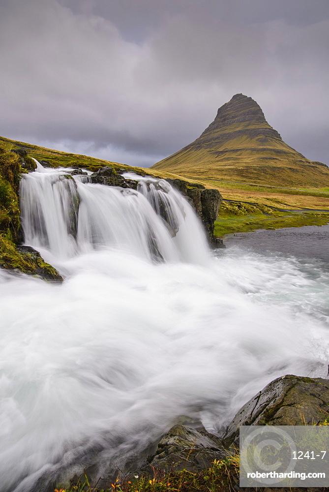 Rushing glacial run-off feeds Kirkjufellfoss on the Snaefellsness Peninsula, Iceland, Polar Regions