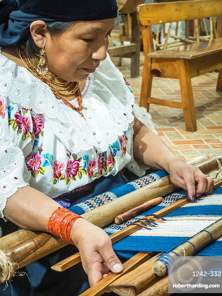 Indigenous woman weaving with backstrap loom, Otavalo, Ecuador, South America