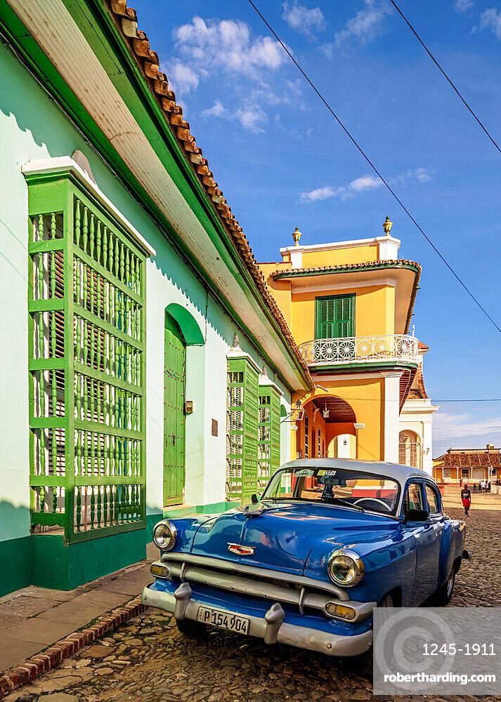 Vintage car on the cobbled street of Trinidad, Sancti Spiritus Province, Cuba, West Indies, Caribbean, Central America