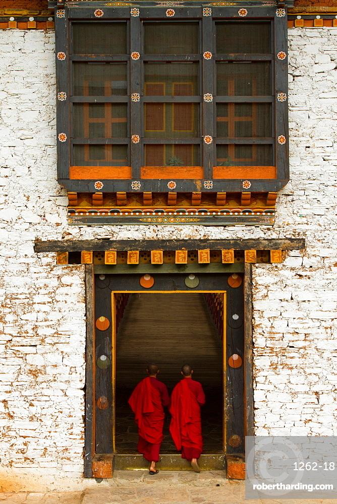 The Punakha Fortress and Buddhist monks, Paro, Bhutan, Asia