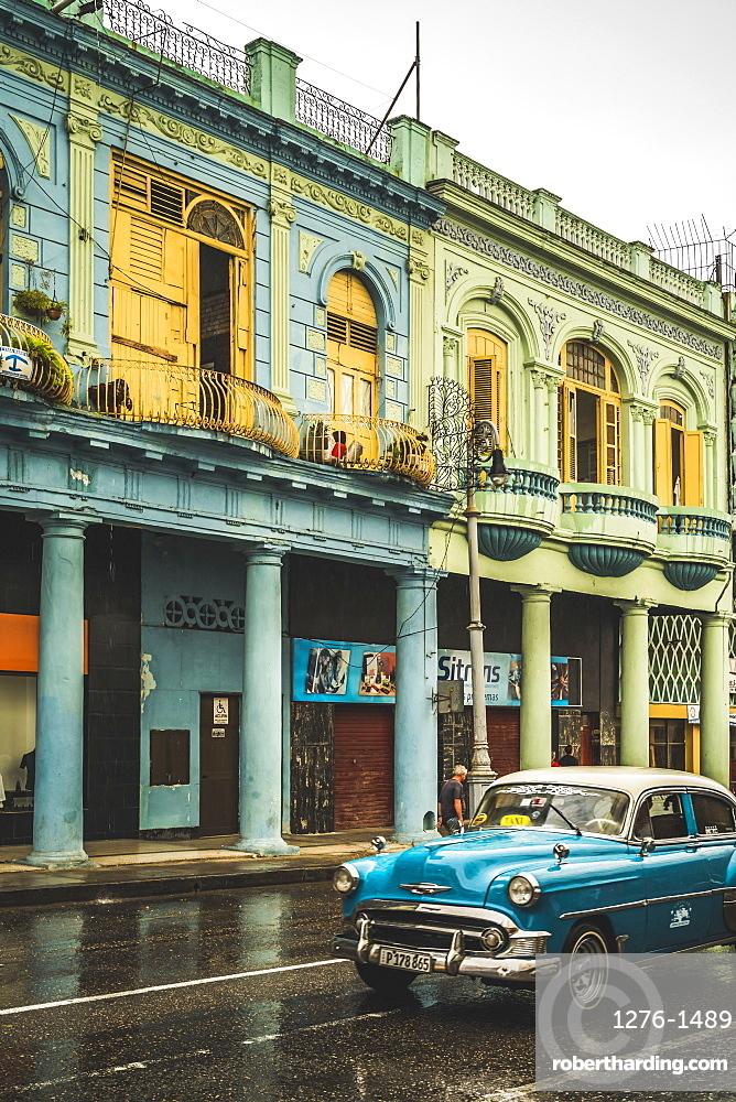 Turquoise vintage taxi in the rain, La Habana (Havana), Cuba, West Indies, Caribbean, Central America