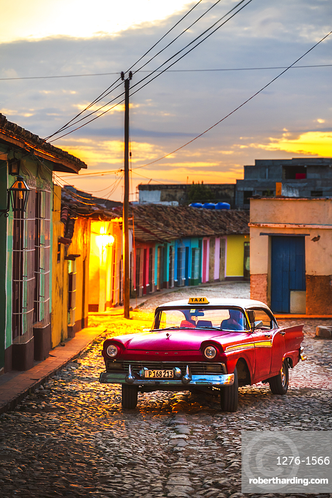 Vintage American taxi at dusk in Trinidad, UNESCO World Heritage Site, Sancti Spiritus, Cuba, West Indies, Central America
