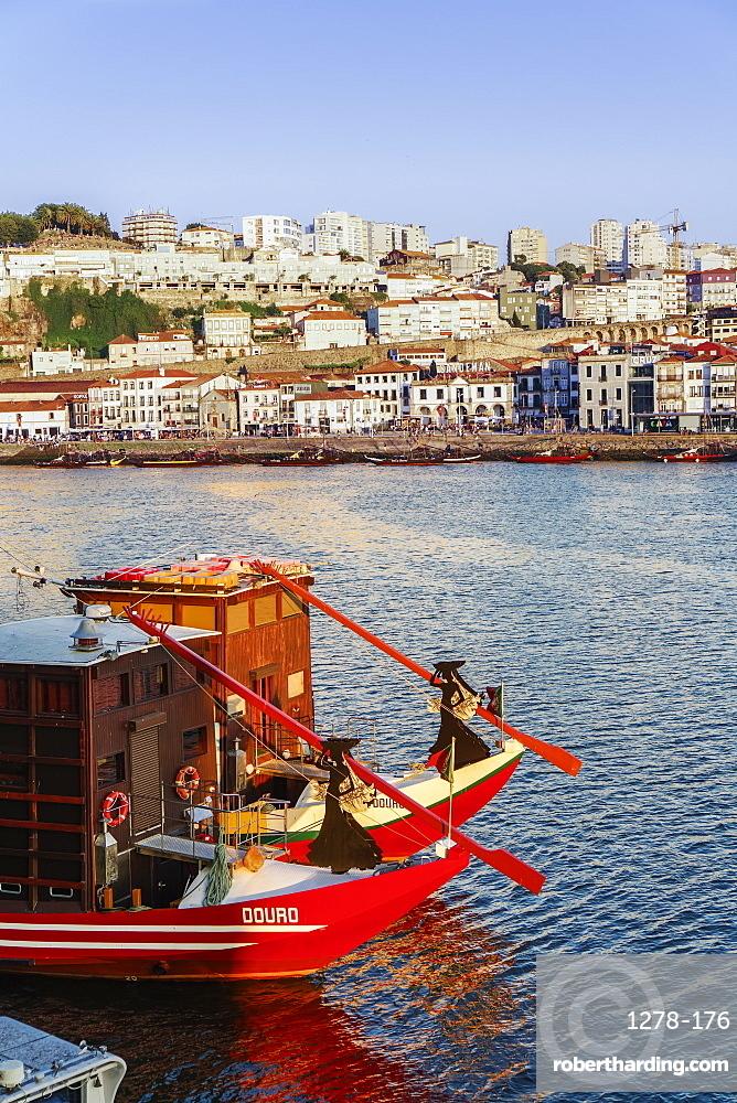 Evening view of tourist boats on the Douro River looking towards Vila Nova de Gaia and Porto wine shops, Porto, Portugal, Europe