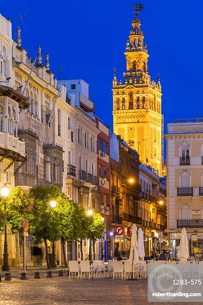 The Giralda Bell tower seen from San Francisco Square at dusk, Seville, Andalusia, Spain, Europe