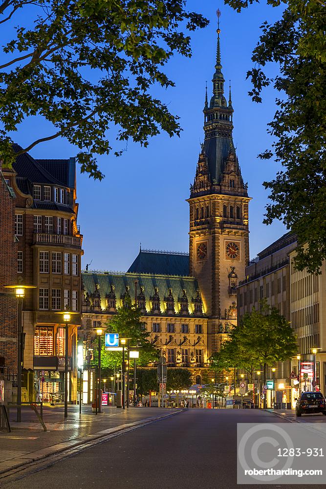 Illuminated town hall seen from Moenckebergstrasse at dusk, Hamburg, Germany, Europe
