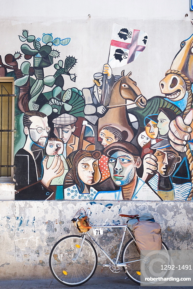 Bicycle and mural in Orgosolo, Sardinia, Italy, Europe