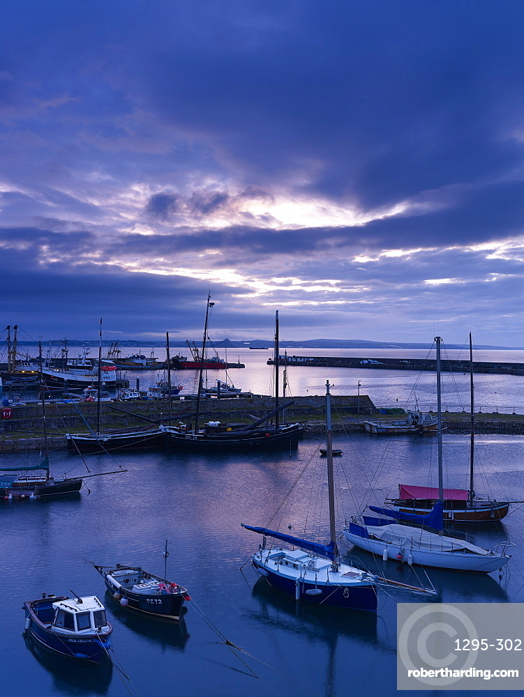 Spring twilight across the harbour at the fishing port of Newlyn, Cornwall, England, United Kingdom, Europe