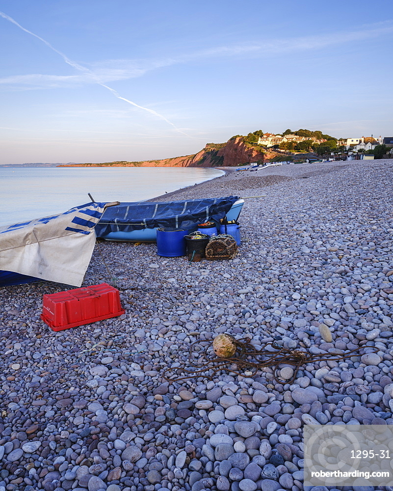 Fishing boats and gear on the pebbled beach at Budleigh Salterton, Devon, England, United Kingdom, Europe