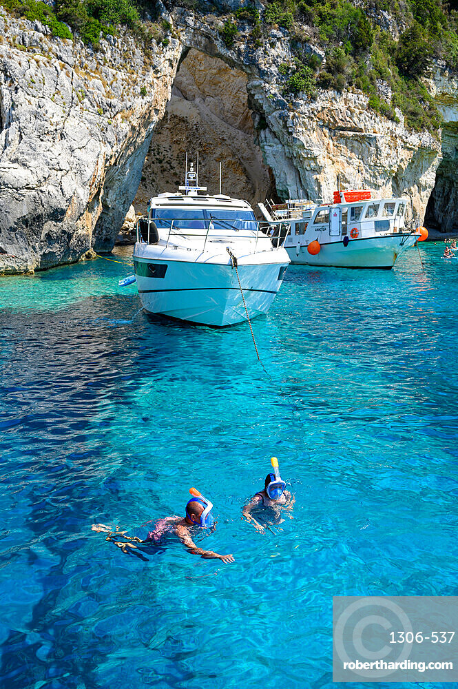 Tourists snorkelling at the Blue Caves, Paxos, Ionian Islands, Greece