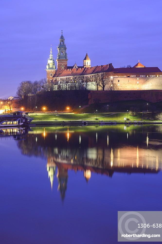 Wawel Castle reflected in the Vistula River, at sunrise, Krakow, Poland