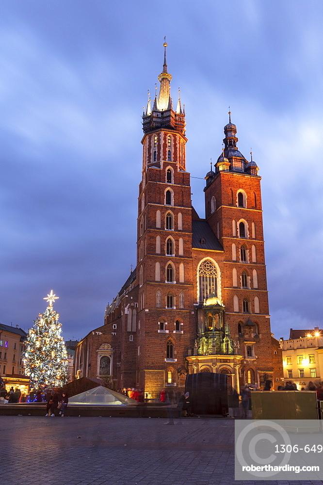 Saint Mary's Basilica at night with Christmas tree, Market Square, Krakow, Poland