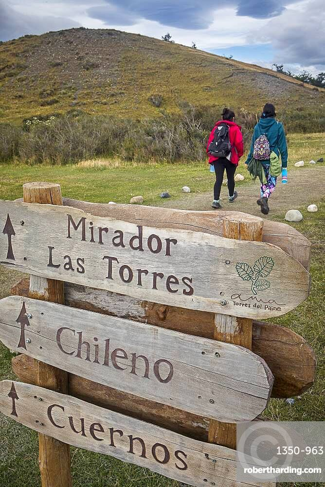 Hikers and signaling in Torres Sector, Torres del Paine national park, Patagonia, Chile