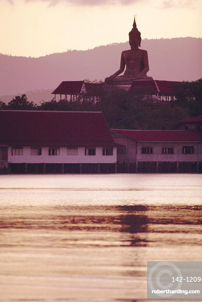 Big Buddha at Koh Faan with Laem Maikaen Cape (hills) in background, Koh Samui (Ko Samui) island, Thailand