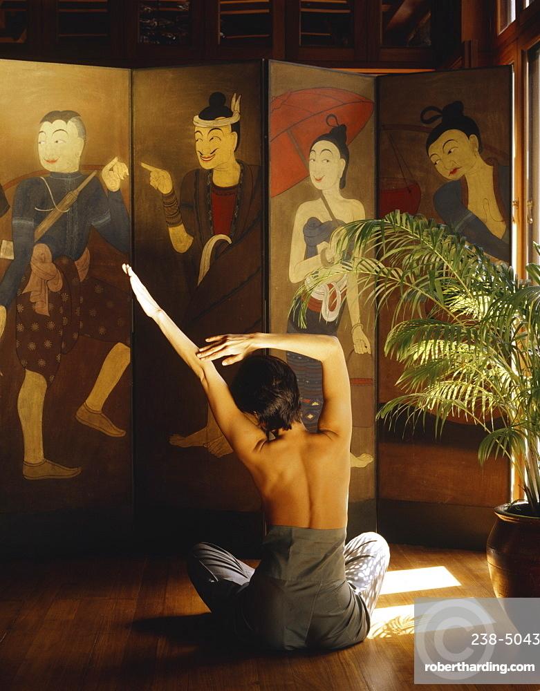 Girl doing Yoga at the Oriental Spa, Bangkok, Thailand, Southeast Asia, Asia