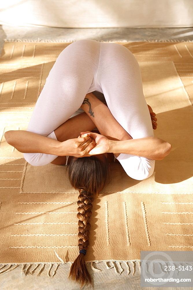 Pindasana posture, yoga at Tent at Shreyas Retreat, Bangalore, Karnataka, India, Asia