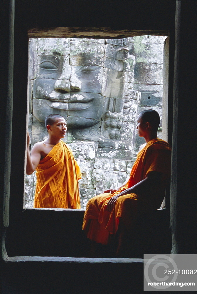 Buddhist monks at the Bayon temple, Angkor, UNESCO World Heritage Site, Siem Reap, Cambodia, Indochina, Asia