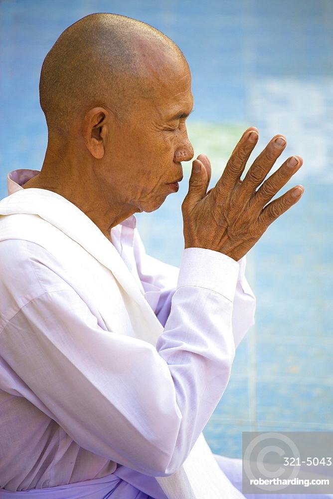 Buddhist monk praying at Botataung Paya (Botataung Pagoda), Yangon (Rangoon), Myanmar (Burma), Asia