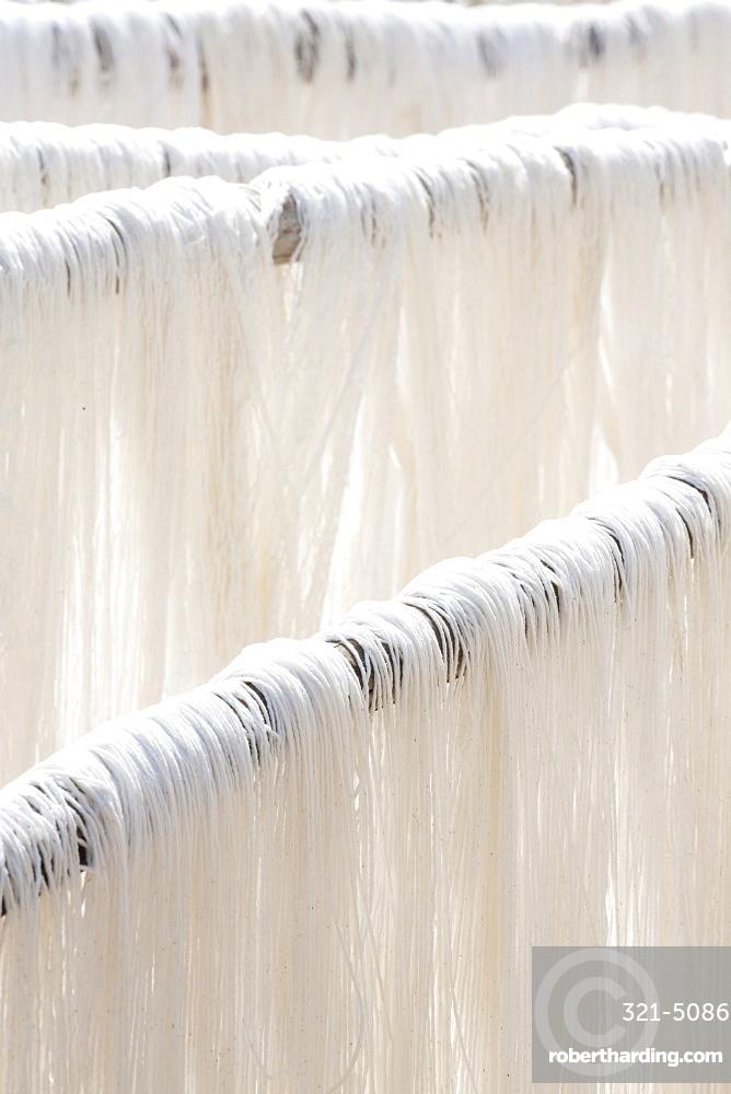 White silk drying in the sun on bamboo racks, Amarapura, near Mandalay, Myanmar (Burma), Southeast Asia
