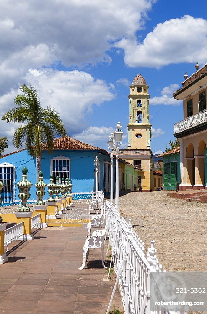 View across Plaza Mayor towards Museo Romantico and the belltower of The Convento de San Francisco de Asis, Trinidad, UNESCO World Heritage Site, Cuba, West Indies, Central America