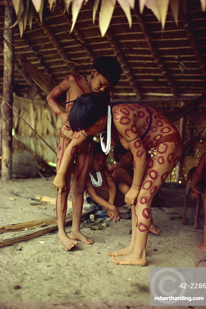 Yanomami indian girls painting each other, Brazil, South America
