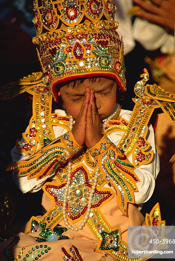 Boy about to become a monk, Shwedagon Pagoda, Yangon (Rangoon), Myanmar (Burma), Asia