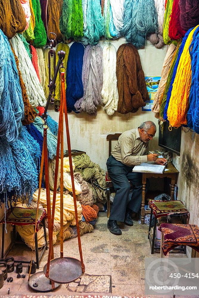 Carpet wool dealer, Old Bazaar, Kashan, Iran, Middle East