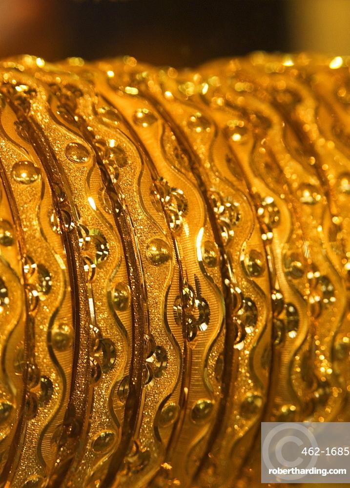Close up of gold bangles on display, the Gold Souk, Deira, Dubai, United Arab Emirates, Middle East