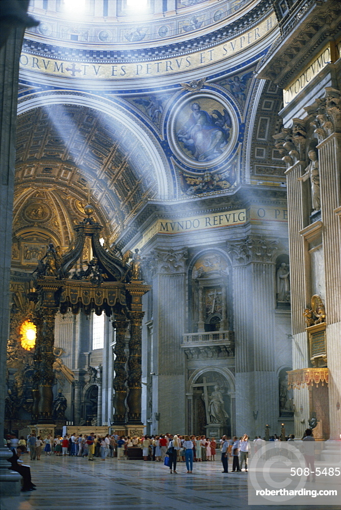 Tourists in the interior of St. Peters Basilica in Rome, Lazio, Italy, Europe