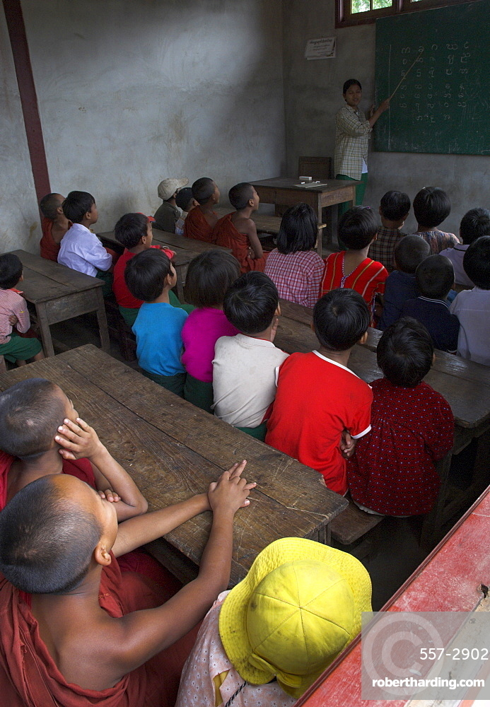 School children in classroom listening to teacher in new school building built by local NGO, village of Thit La, Shan State, Myanmar (Burma), Asia