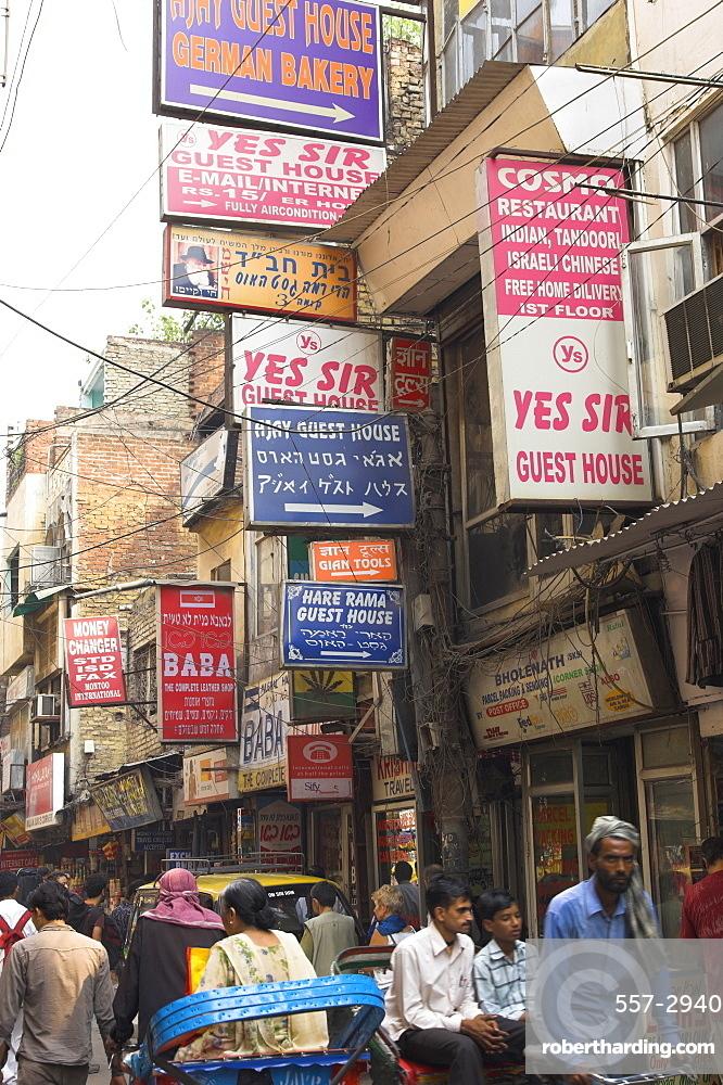 People riding rickshaws and street signs, Pahar Ganj, Main Bazaar, New Delhi, Delhi, India, Asia