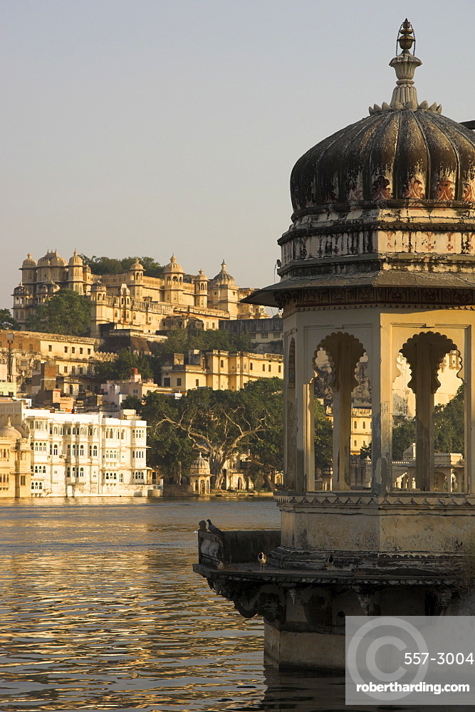 View of city palace and old city across Pichola Lake with decorative lookout tower in foreground, Udapiur, Rajasthan state, India, Asia