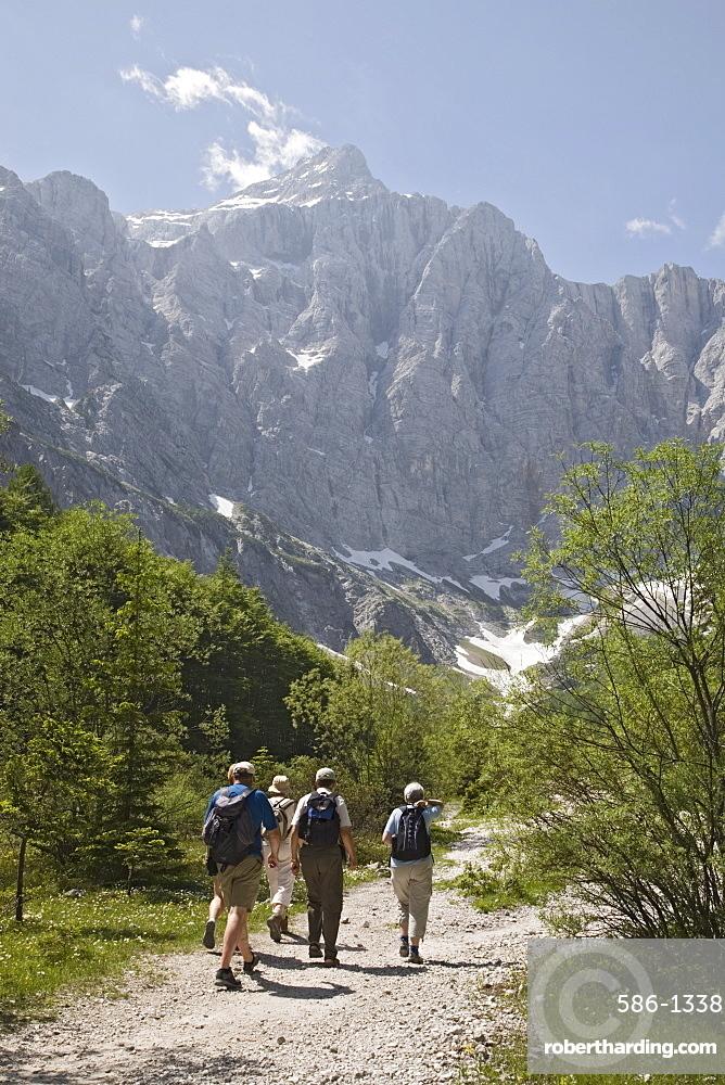 Tourist group in summer in Vrata valley walking towards Triglav mountain, the highest in Slovenia, Triglav National Park, Julian Alps, Mojstrana, Dolina, Slovenia, Europe