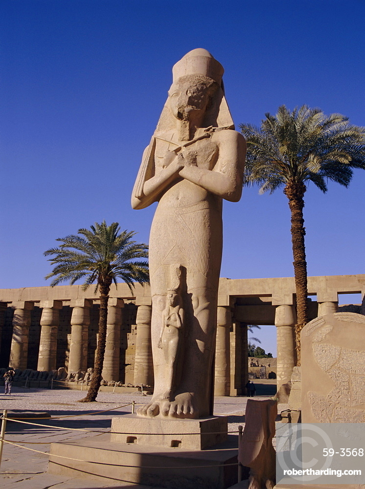 Statue of Amun, with Ramses II (Ramasses the Great) between his knees, Karnak, UNESCO World Heritage Site, Thebes, Egypt, North Africa, Africa