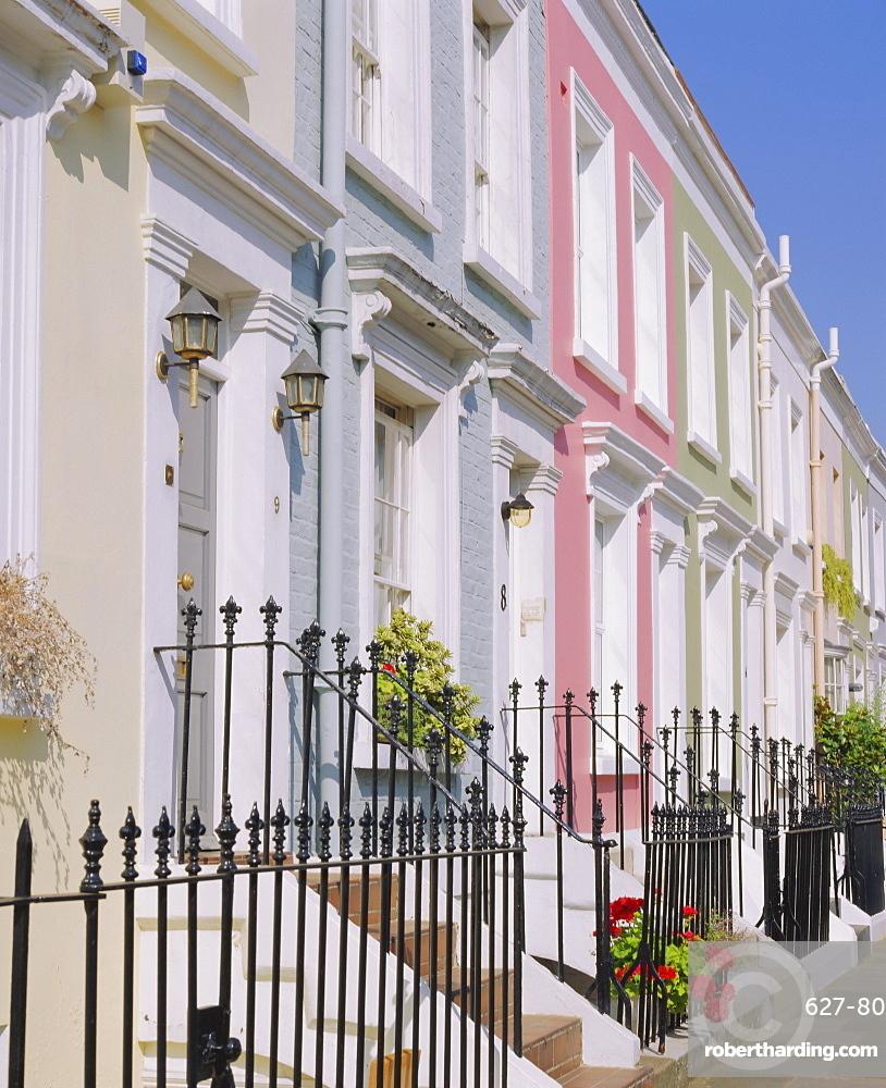 Terraced houses and wrought iron railings, Kensington, London, England, UK