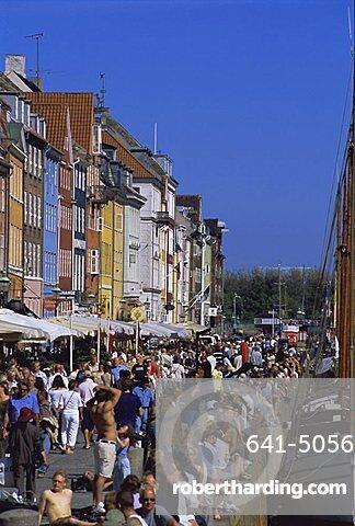 Busy waterfront, Nyhavn, or new harbour, restaurant area, Copenhagen, Denmark, Scandinavia, Europe
