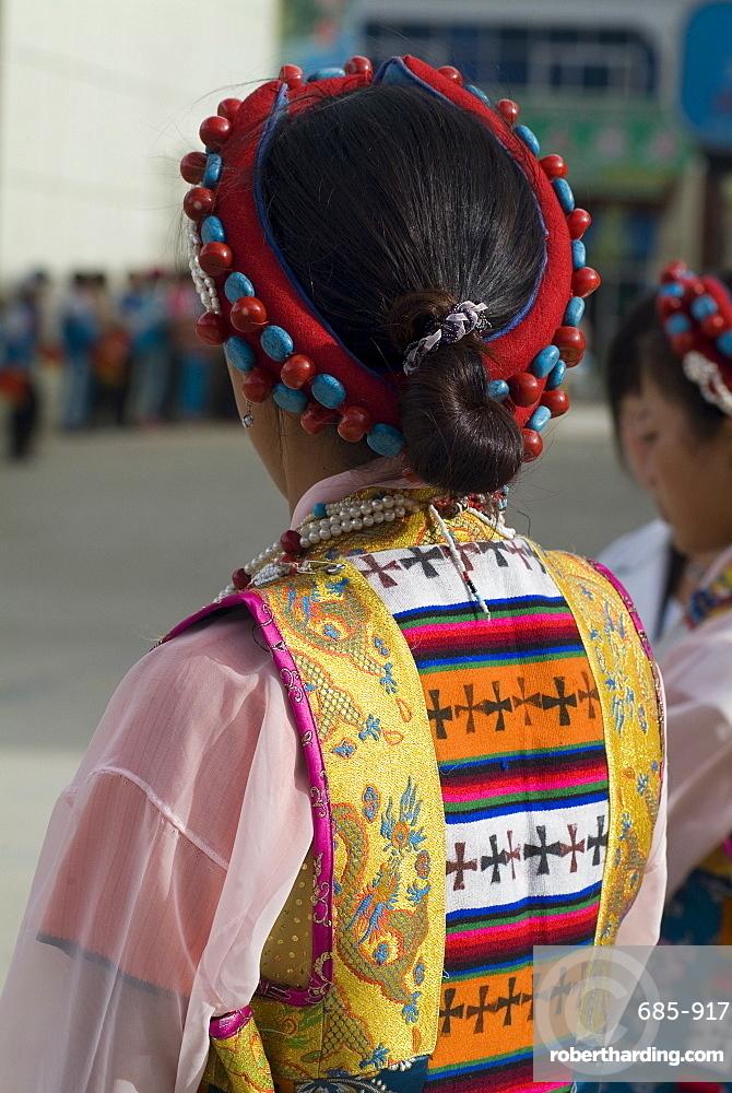 Dancer in traditional dress, Gyantse, Tibet, China, Asia