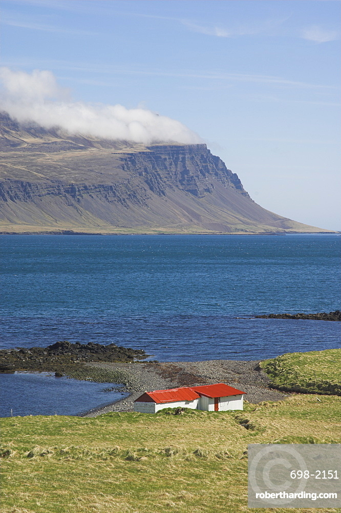 Red roofed farm buildings, Faskrudsfjordur, East area, Iceland, Polar Regions