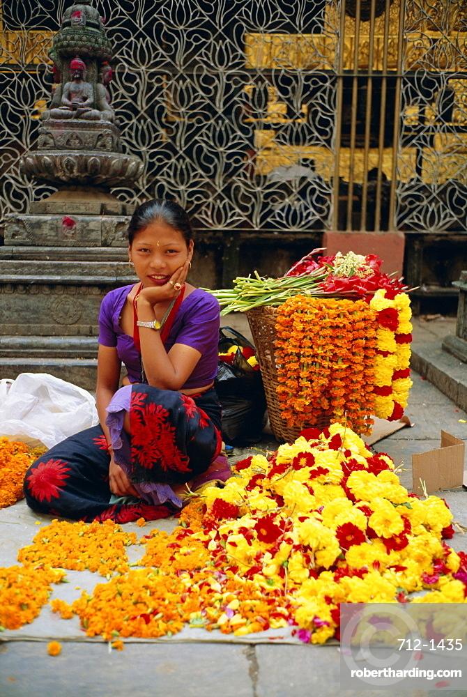 Woman selling flowers, Asan Tole Buddhist temple, Kathmandu, Kathmandu Valley, Nepal, Asia