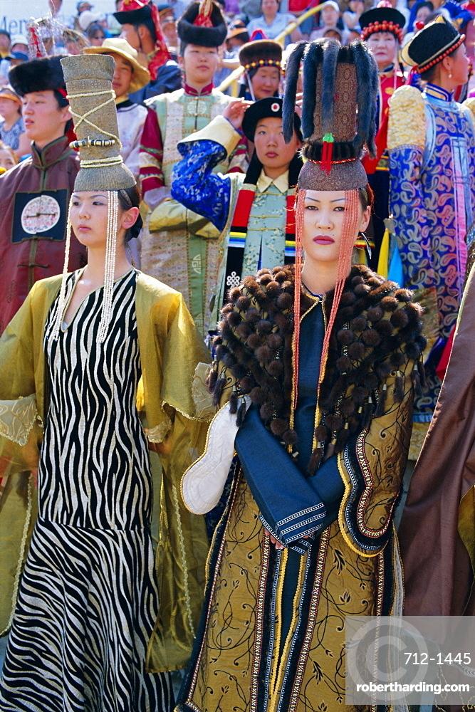 People in traditional costumes at the tournament, Naadam Festival, Ulaan Baatar (Ulan Bator), Mongolia, Asia