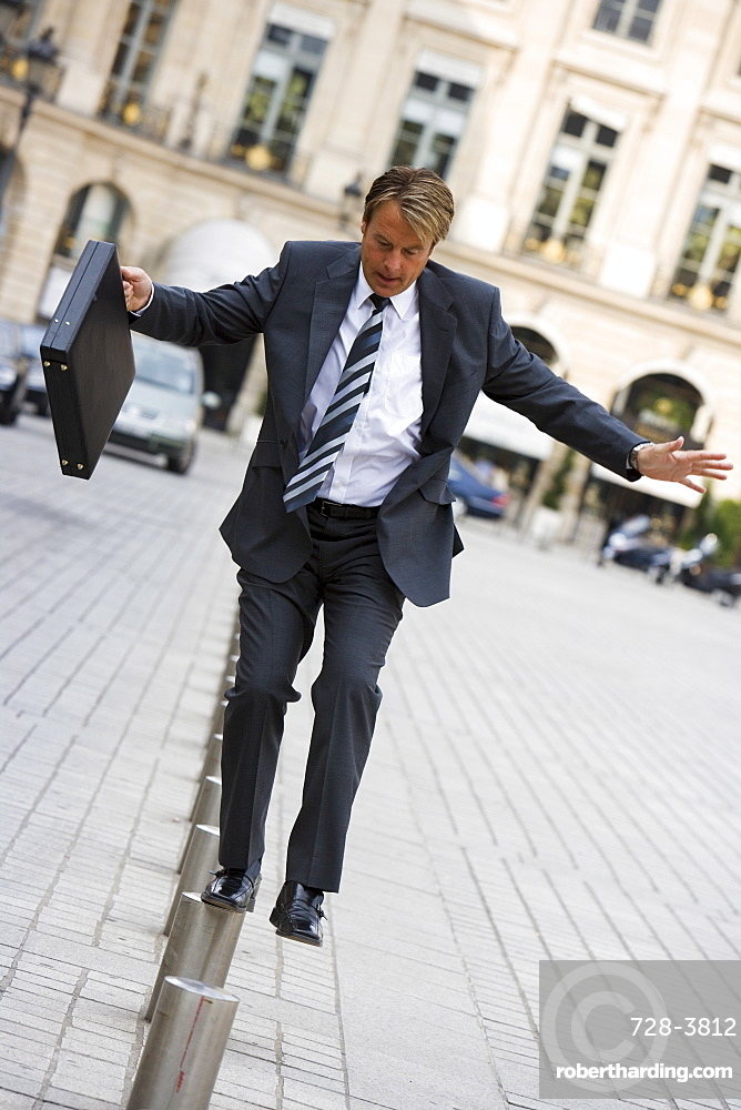 Business man balancing, Paris, France, Europe