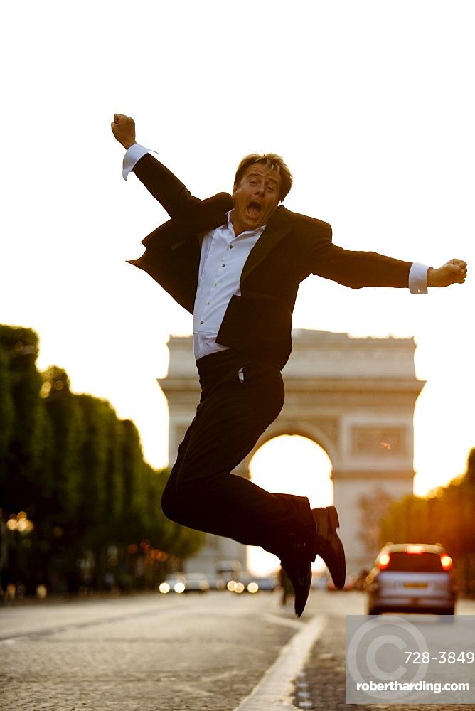 Man jumping, Champs Elysees, Paris, France, Europe