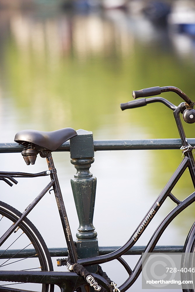 Bike at canal edge, Amsterdam, Holland (The Netherlands), Europe