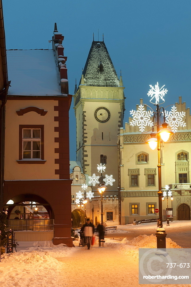 Snow-covered Christmas decorated lamps and Gothic Town Hall, Tabor, Jihocesky, Czech Republic, Europe