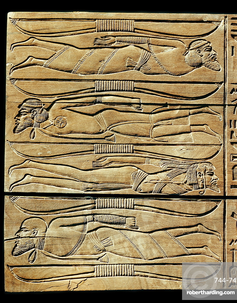 Detail from the ceremonial footstool of the king, showing conquered adversaries and enemies of Egypt including a Syrian, Libyan, Nubian and Sudanese, from the tomb of the pharaoh Tutankhamun, discovered in the Valley of the Kings, Thebes, Egypt, North Africa, Africa