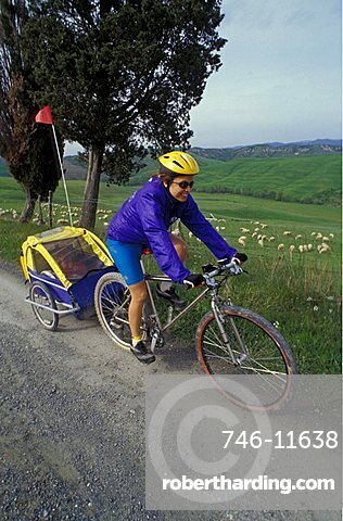 Bike with baby trailer in the country, Biking around Italy