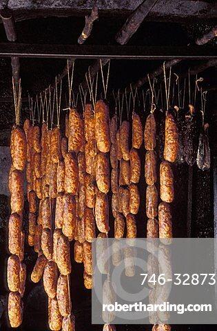Smoking sausages, San Lorenzo In Banale, Trentino Alto Adige, Italy