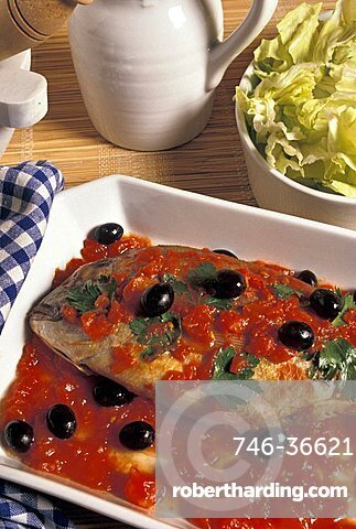Dentex with tomatoes and black olives, Italy