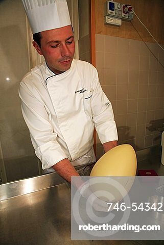 Chocolate egg is ready for decoration, Easter egg preparation, Bar Centrale, Lecco, Lombardy, Italy